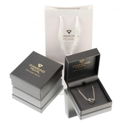 Packaging de la bague en perles de culture blanche et noire