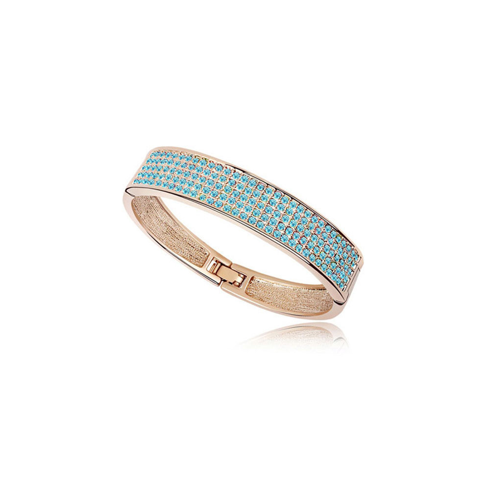 bangle-bracelet-made-with-a-blue-crystal-from-swarovski-and-yellow-gold-plated