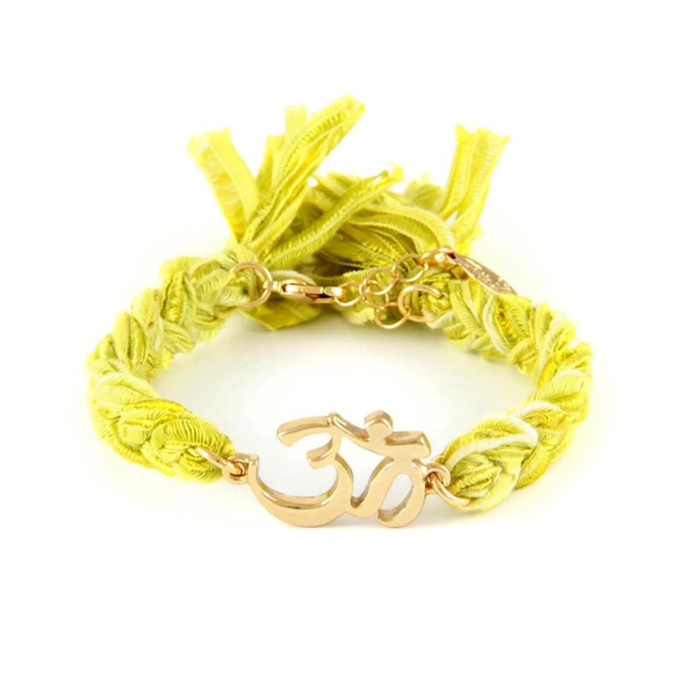 ettika-yellow-ribbons-and-yellow-gold-om-bracelet