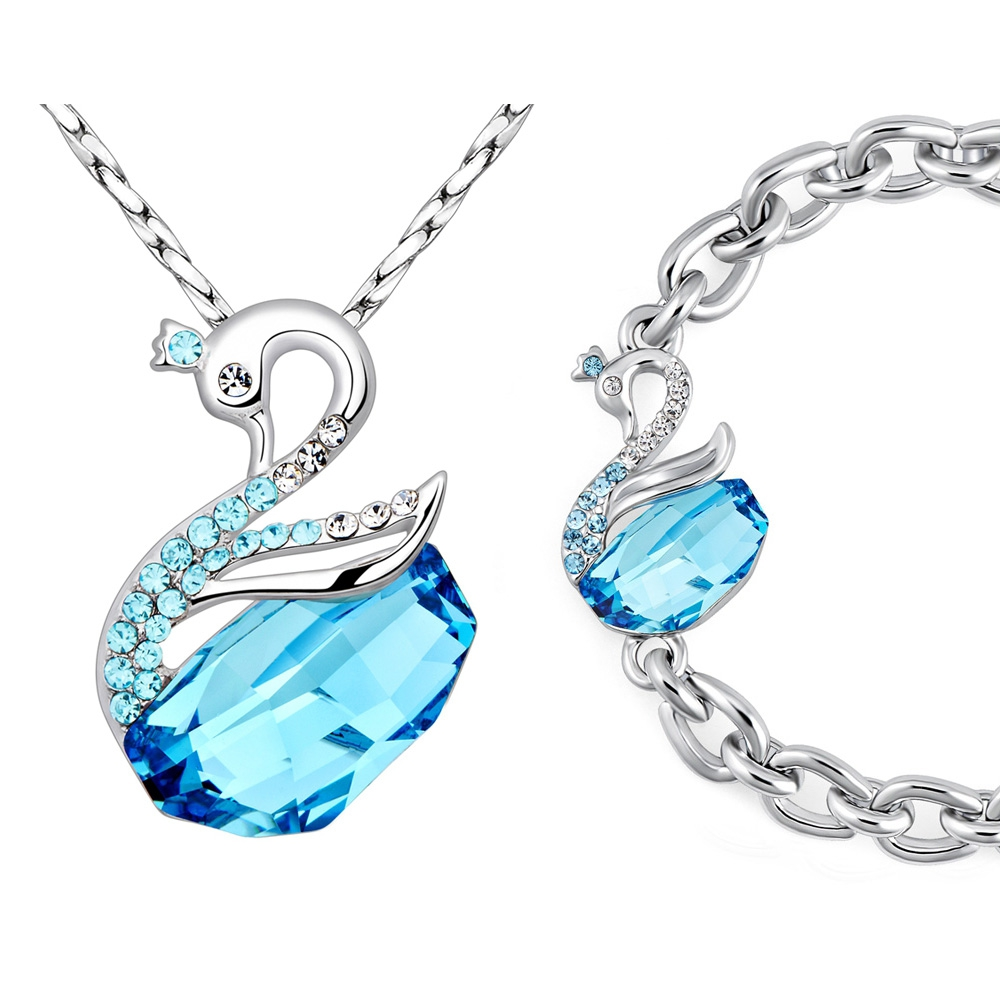 parure pendentif et bracelet cygne en cristal de swarovski element bleu parures blue pearls. Black Bedroom Furniture Sets. Home Design Ideas